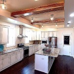 Gourmet's Dream Kitchen Dressed In Granite And Toped With Rustic Beams